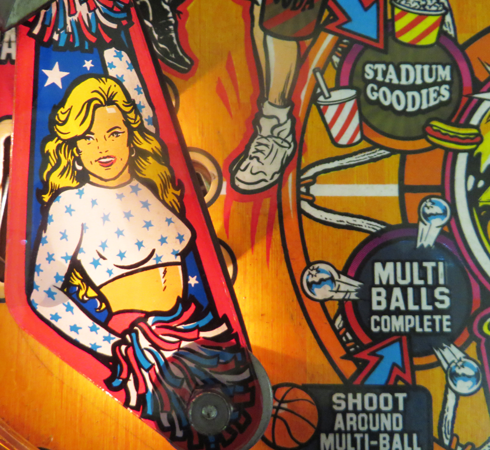 From NBA Fastbreak, my other favorite pinball machine. Shoot baskets behind the backglass, pass back and forth - it's a clever one. And there's just a little dash of T, minus the A, down by the flippers.