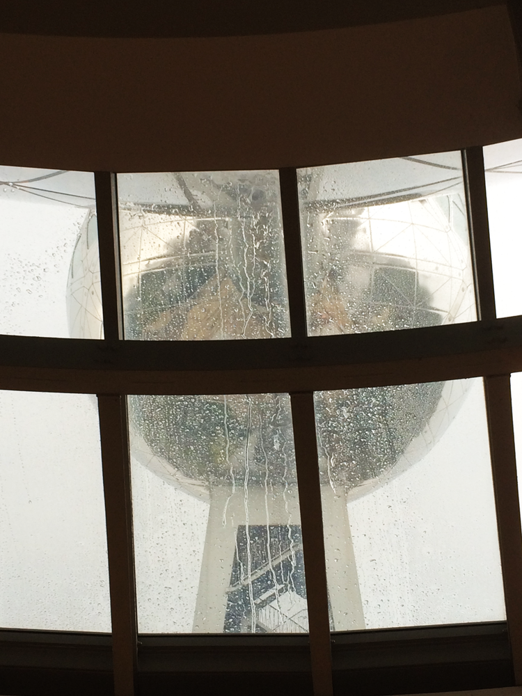 The Atomium, glimpsed from inside through a rain-covered window