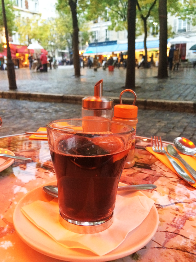 A cup of hot wine at Place de Tertre in Paris