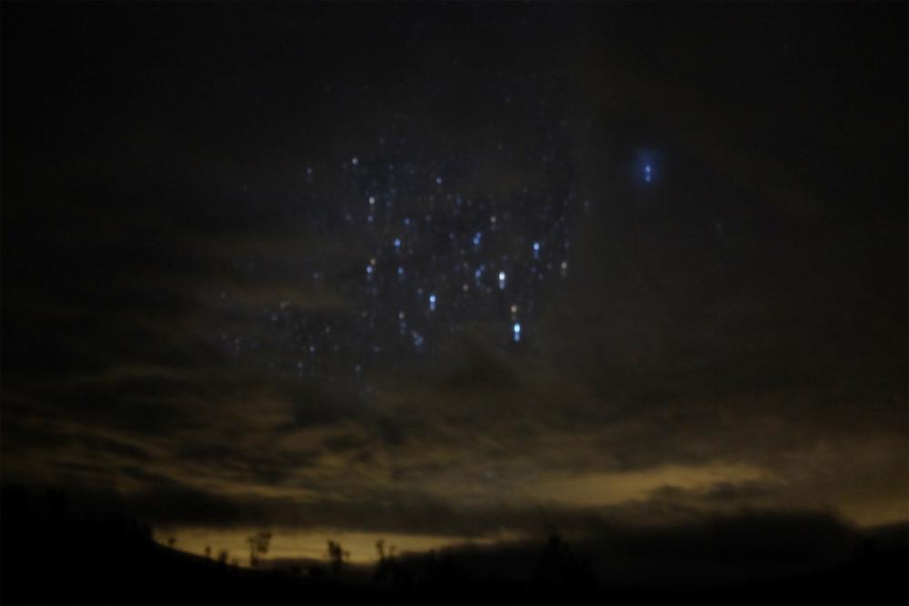 Long-exposure photo of stars and the horizon in Santa Margarita, CA
