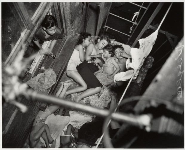 Weegee-Children-Family-Sleeping-on-a-Fire-Escape-1938