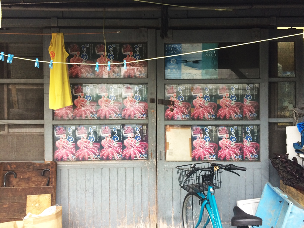 Octopus posters in a window at Tokyo's Tsukiji Market