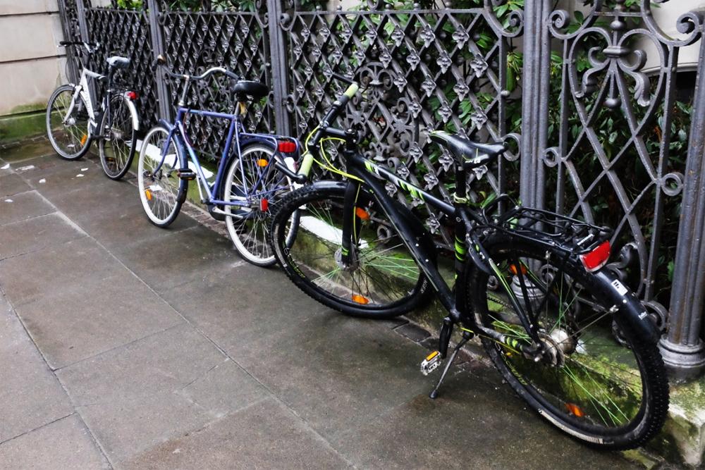 copenhagen-bikes-by-fence