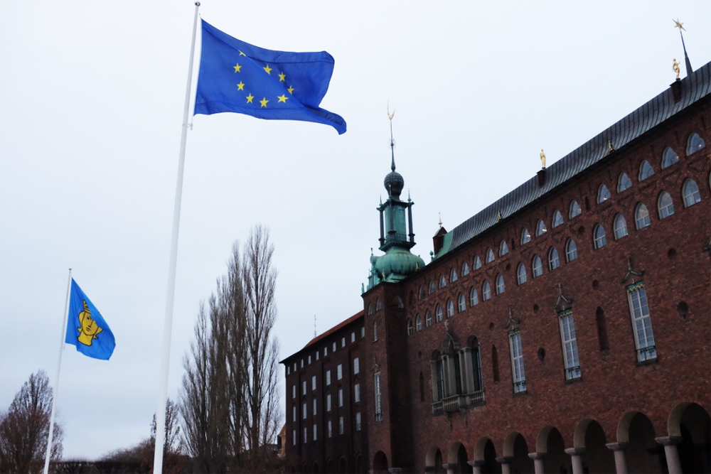 Stockholm's city hall's exterior from the street, with EU flag