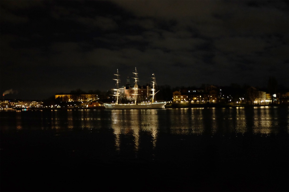 The Af Chapman at night, from across the harbor