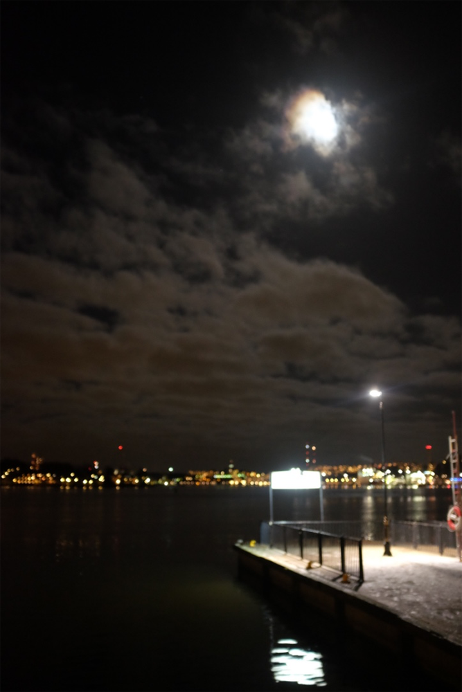 The moon over Sodermalm and Stockholm Harbor