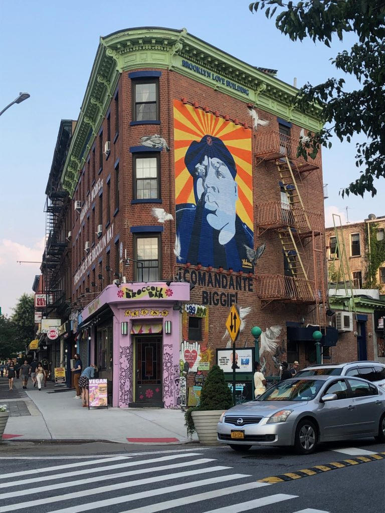 a mural of the Notorious B.I.G. on the Brooklyn Love building