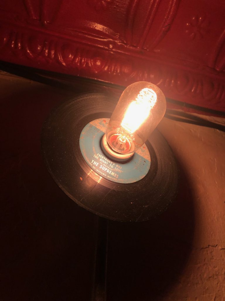 a lightbulb sticks out of a Supremes record